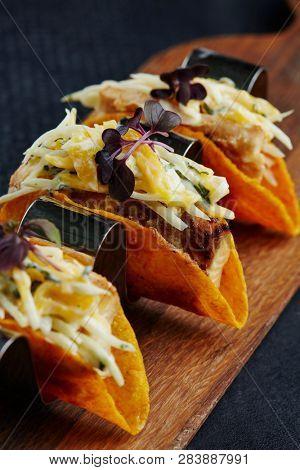 mini corn tacos with cod filling