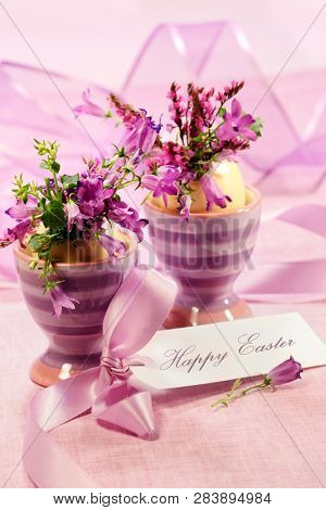 Purple flowers in egg cups for Easter