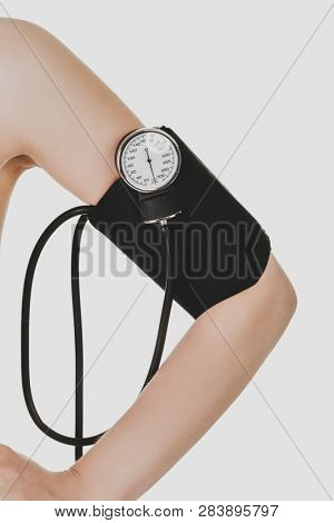 Woman arm with sphygmomanometer isolated on white background.