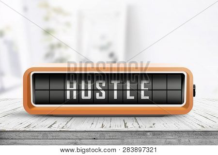 Hustle Alarm On A Wooden Table In A Bright Room With A Retro Device