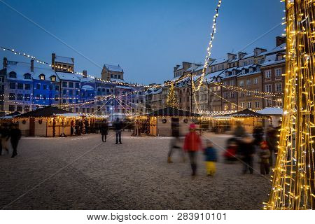 Warsaw Old Town Square With Christmas Lights And Snow