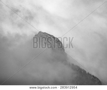 Top of a mountain in fog and clouds