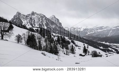 moody winter scenery of alpine mountains covered with snow