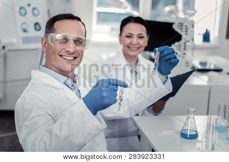 Smiling Scientist Is Happy With His Scientific Achievements