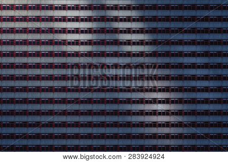 Architectural Pattern, Concrete Facade With Red Windows In The Night