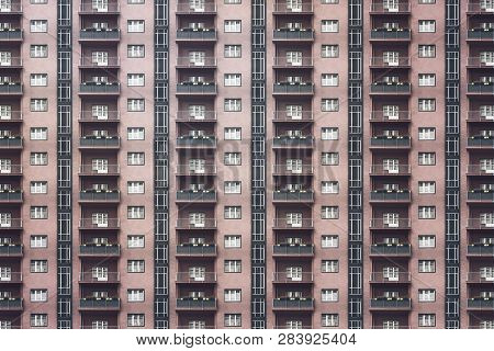 Architectural Pattern, Dark Facade With Windows And Balconies Of A Miserable Berlin House