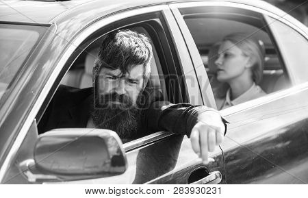 Business Woman Sit On Backseat While Bearded Driver Sit In Front. Car With Open Windows And Passenge