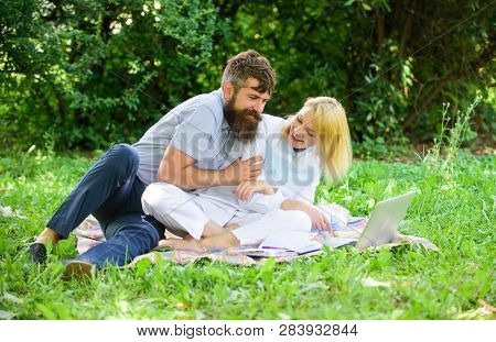 How To Balance Freelance And Family Life. Couple Youth Spend Leisure Outdoors Working With Laptop. C