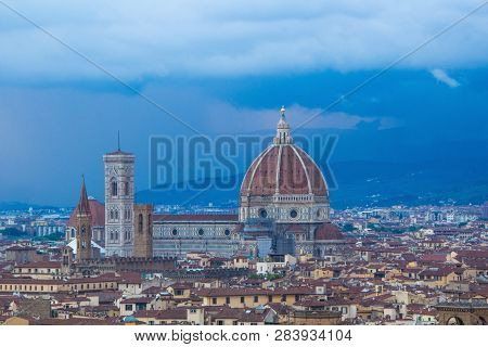 Cathedral Of Santa Maria Del Fiore (duomo) In The Evening. Florence Duomo With Dramatic Dark Blue Sk