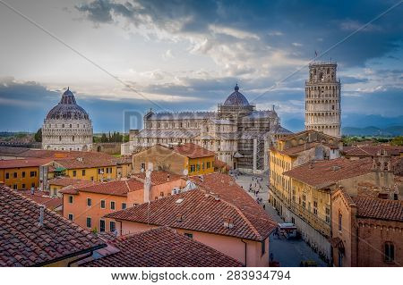 Sunset aerial view of Pisa historic center with famous leaning tower and Duomo di Pisa cathedral. Toscana, Italy poster