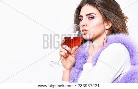 Woman Enjoy Wine. Girl Fashion Makeup Wear Fur Coat Hold Wine Glass. Lady Curly Hairstyle Like Expen