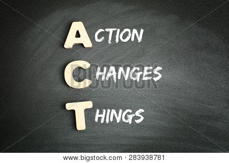Wooden Alphabets Building The Word Act - Action Changes Things Acronym On Blackboard