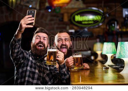 Online Communication. Man Bearded Hipster Hold Smartphone. Taking Selfie Concept. Take Selfie Photo