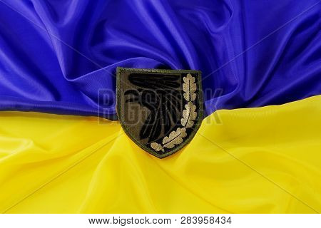 Green Military Chevron Of The Ukrainian Army, On The Yellow-blue State Flag Of Ukraine. February 12,
