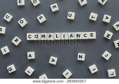 Compliance Word Made Of Square Letter Word On Grey Background.