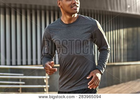Happy To Be Healthy. Close-up Portrait Of Handsome And Positive African Man In Sportswear Starting T