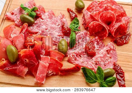Cured Meat Platter Of Traditional Spanish Tapas - Chorizo, Salsichon, Jamon Serrano, Lomo - Erved On