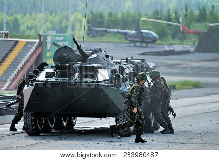 Nizhniy Tagil, Russia - July 12. 2008: Group Of Special Forces Unload From Btr-82a Armoured Personne