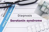 Diagnosis Serotonin Syndrome. Medical notebook labeled Diagnosis Serotonin Syndrome, psychiatric mental questionnaire, pills are on table in psychiatrist cabinet or counselor of this issue or problem poster