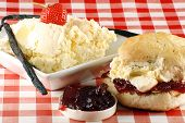 traditional cream ccone with cream and strawberry jam poster