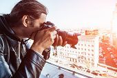Paparazzi or investigator or private detective taking photo with professional camera, toned poster