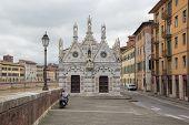 Small gothic church Santa Maria della Spina near the river Arno in Pisa, Italy. Cloudy, rainy weather. Pisa, Italy. poster