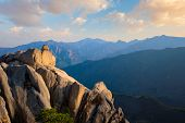 View of stones and rock formations from Ulsanbawi rock peak on sunset. Seoraksan National Park, South Corea poster