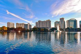 Orlando, Florida . December 25 , 2018. Lake Eola Park And Colorful Business Buildings On Beautiful S