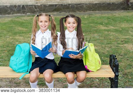 Read To Succeed. Happy Readers Outdoors. Little Children Read Books On Bench. Home Reading. Back To