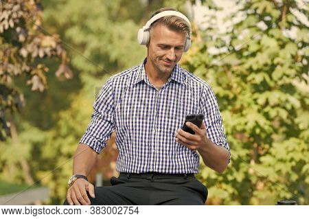 Technology For Audio Fan. Happy Man Choose Music In Smartphone. Headphone Wireless Technology. New T
