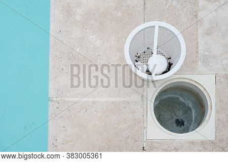 Swimming Pool Skimmer Basket Containing Chlorine Tablets