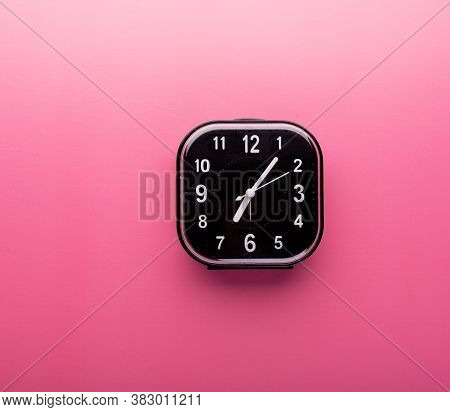 Alarm Clock Isolated On Bright Pink Background With Copy Space. Morning Waking Up, Time Or Deadline
