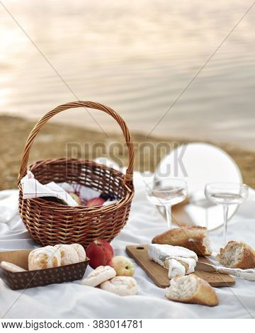 Summer - Picnic On The Beach . Cheese Brie, Baguette, Peaches, Champagne And Basket