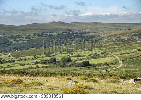 Panoramic Landscape View Across Dartmoor National Park In Summer With Wide Views Of Several Tors And