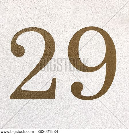 Number Twenty-nine In Arabic Numerals - House Number 29 In Gold Paint On Wall