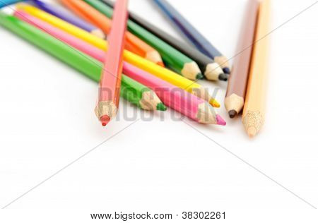 Multi Color Pencils On White Background.