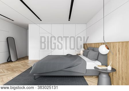 Inteiror Of Modern Bedroom With White And Wooden Walls, Wooden Floor And Comfortable King Size Bed.