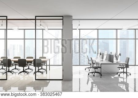 Interior Of Stylish Open Space Office With Panoramic Window, White Marble Walls And Rows Of Computer
