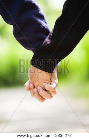Senior Holding Hands