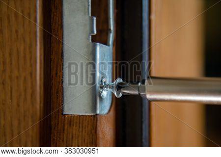 Close Up Of Carpenter Repairing Door Lock. Installing A Door Handle. Handyman Tightening Door Hinge