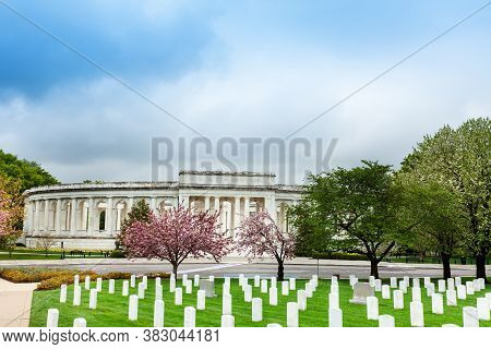 The Arlington Memorial Amphitheater Over National Cemetery Tombstones With Blooming Cherry Trees, Vi