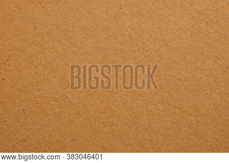 The Surface Of Light Brown Cardboard. Rough Paper Texture With Cellulose Fibers. Discreet Beige. Bac