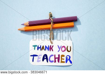 Thank You Teacher Written On Paper Note With Color Pencils, Happy Teacher's Day Conceptual Photo