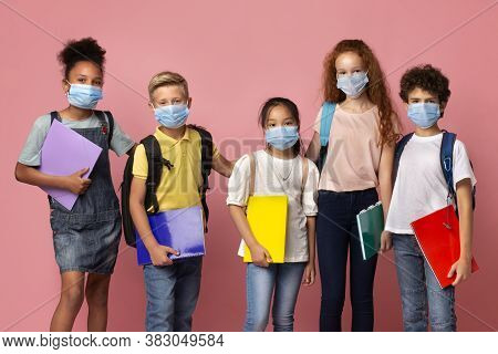 Education During Quarantine Concept. Portrait Of Diverse Schoolchildren Wearing Medical Masks On Pin