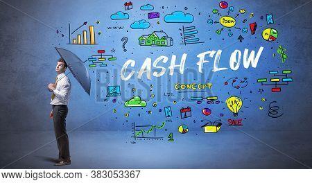 Determined businessman hiding behind umbrella with CASH FLOW inscription, new business concept