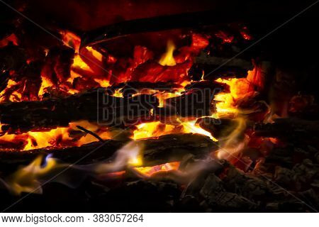 Red Coals With Fire On Black Background. Burning Coals And Wood In Fire. Burning Wood To Keep Warm A