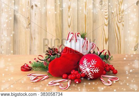 Christmas Decoration With Christmas Stocking, Pine Cone,  Branch Of Spruce, Candies, Berry And Chris