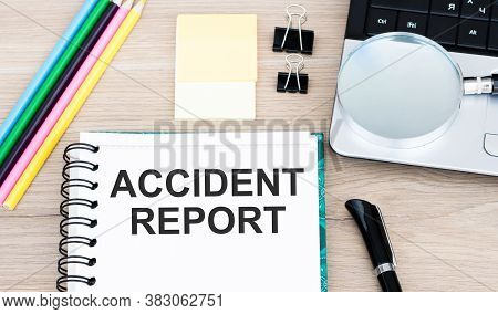 Accident Report Text On A Notebook Lying On The Table.