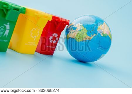Yellow, Green And Red Recycle Bins With Recycle Symbol On Blue Background. Keep City Tidy, Leaves Th