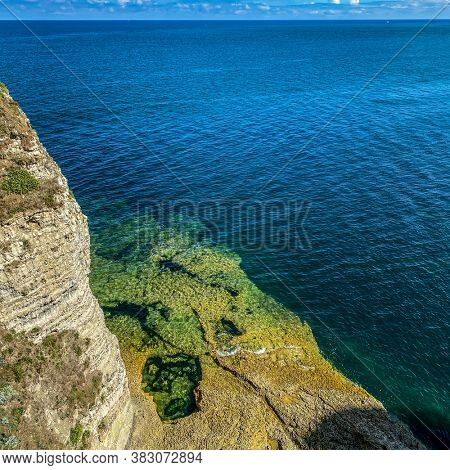 Pool on the Limestone cliffs at Etretat, French Coast